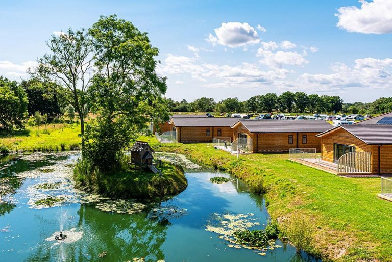 Waterside log cabins at Flaxton Meadows